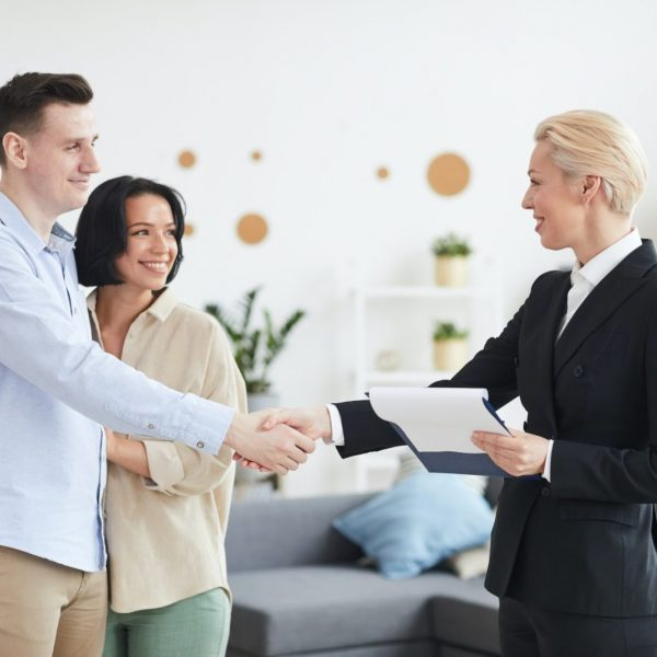 Couple cooperating with realtor
