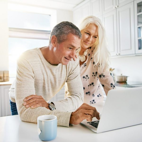 Elderly retired couple reading their social media